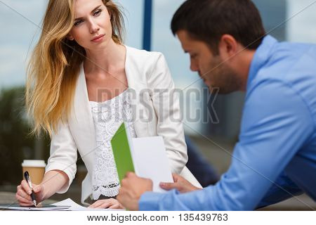 Man and woman discuss something at work. Business concept.
