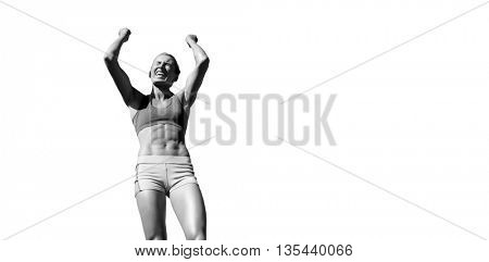 Low angle view of sportswoman celebrating her victory against white background