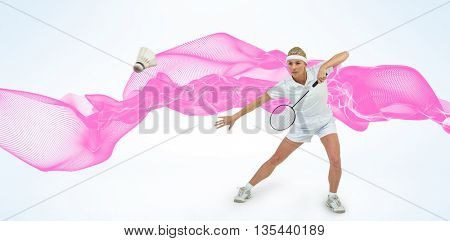 Composite image of badminton player playing badminton against design background