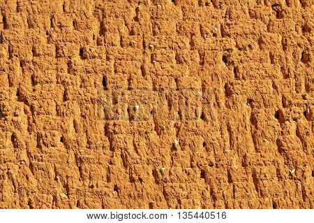 Stylish colorful adobe wall background close up