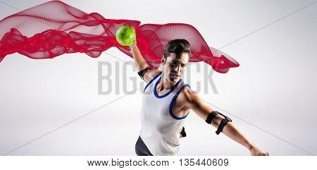 Confident athlete man throwing a ball against blue design