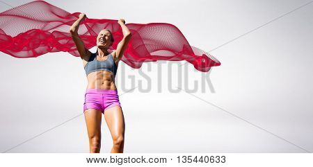 Low angle view of sportswoman celebrating her victory against blue design