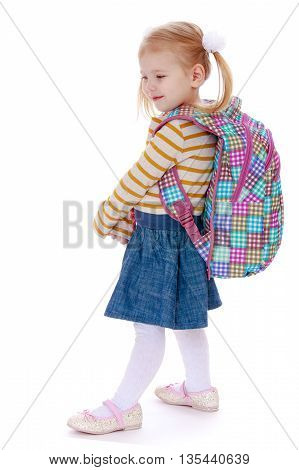 Fair-haired little girl with a big knapsack on his back - Isolated on white background