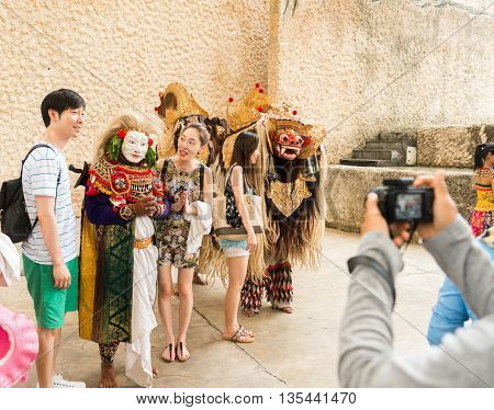 GWK, Bali Indonesia - May 14, 2013 - Tourists taking snaps after Barong Dance show, the traditional Balinese performance on May 14, 2013.