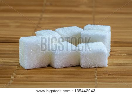 Refined Sugar On Bamboo Background