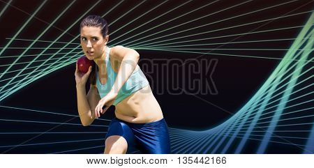 Sportswoman practising the shot put against blue angular design
