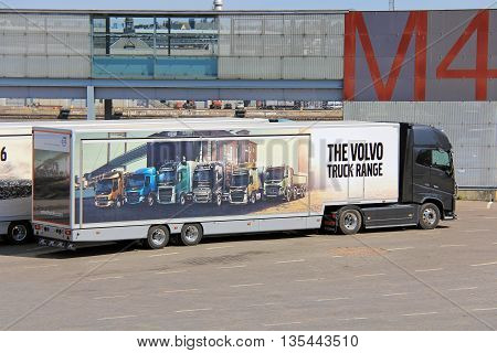 HELSINKI, FINLAND - MAY 24 2016: Volvo FH16 750 semi displays Volvo truck range pictured on trailer.