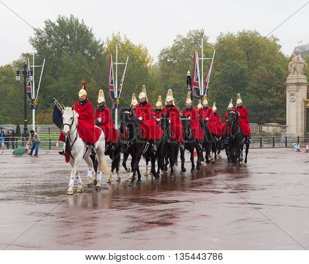 LONDON ENGLAND - OCTOBER 21, 2015: Horse parade arrives at Buckingham palace the London residence and administrative headquarters of the reigning monarch of the United Kingdom