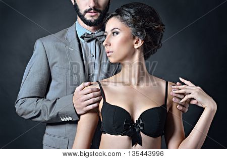 Beautiful Lady In Bra With Handsome Guy In Suit. Young Couple Is Hugging Each Other. Portrait Of Gir
