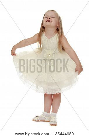 Fancy a little fair-haired girl in a white party dress - Isolated on white background