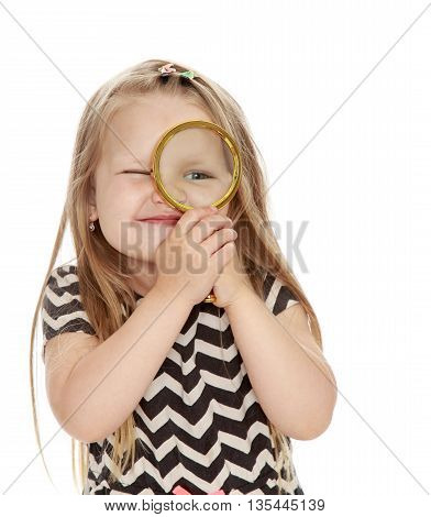 Funny little girl looking through a magnifying glass. Close-up - Isolated on white background