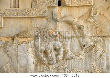 Bas-relief of a bull and a lion at the ruins of Persepolis in Iran. UNESCO declared the ruins of Persepolis a World Heritage Site in 1979.