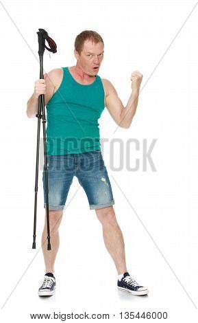 Athletic 50 year old man in t-shirt and shorts , holding a folding Nordic walking sticks-Isolated on white background