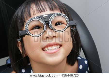 Asian Little Chinese Girl Doing Eyes Examination