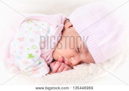 portrait of a beautiful sleeping newborn baby girl