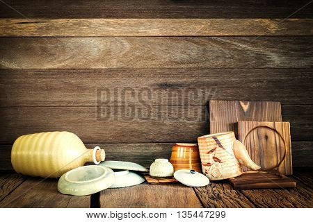 Still life of kitchen accessory drying after washed on wood background.