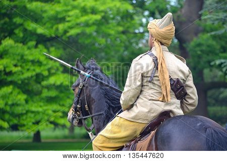 Silsoe, Bedfordshire, England - May 30, 2016:  A member of the Punjab Lancers in World War One uniform riding a horse.