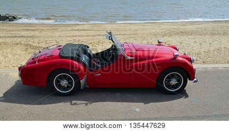 Felixstowe, Suffolk, England - May 01, 2016: Classic Red MGA Open Top Sports car parked on seafront promenade.