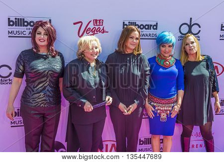 LAS VEGAS - MAY 22 : (L-R) Recording artists Abby Travis Gina Schock Belinda Carlisle Jane Wiedlin and Charlotte Caffey of The Go-Go's attend the 2016 Billboard Music Awards on May 22 2016 in Las Vegas