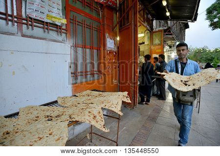 SHIRAZ - APRIL 14: Unknown people trades bread in a market (Vakil Bazaar) in Shiraz Iran on April 14 2015. Vakil Bazaar is the most important tourist attraction in Shiraz Iran.
