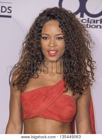 LAS VEGAS - MAY 22 : Actress/singer Serayah poses in the press room at the 2016 Billboard Music Awards at T-Mobile Arena on May 22 2016 in Las Vegas Nevada.