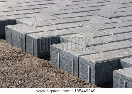 construction of sidewalk from grey paving stones