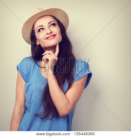 Happy Casual Friendly Woman In Summer Hat Thinking And Looking Up. Toned Closeup Portrait