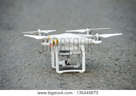 Drone with professional camera standing on the ground
