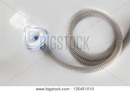 CPAP machine mask and hose for people with sleep apnea respiratory or breathing disorder