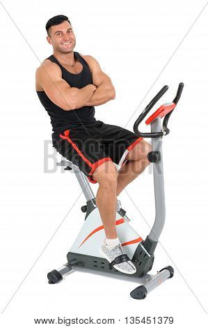 young man posing sitting on indoor bike spinning machine, isolated on white background