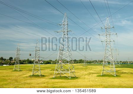 Electric poles with high voltage.By-wire is an electric current of high voltage.