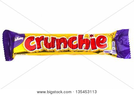 LONDON UK - JUNE 16TH 2016: An unopened Crunchie chocolate bar manufactured by Cadbury pictured over a plain white background on 16th June 2016.