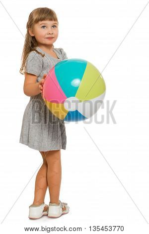 Beautiful little blond girl playing with a bouncy ball - Isolated on white background