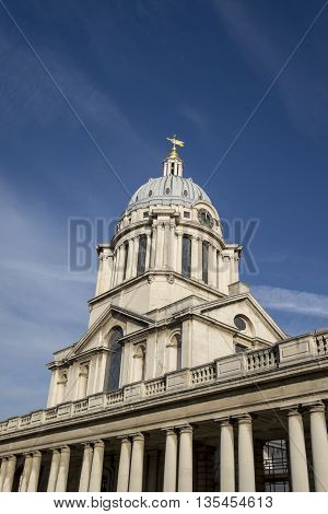 Grand architecture of clock tower in Greenwich London against blue sky