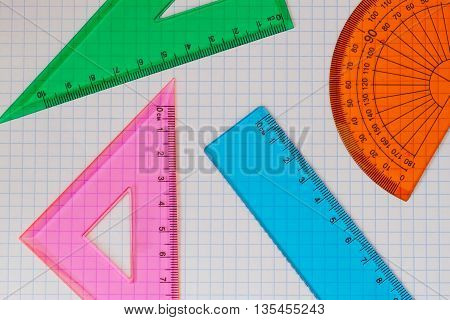Geometry set with triangles, rulers and protractor close up. With your place for the text