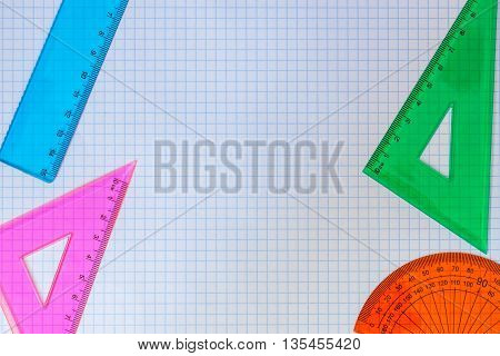 Geometry Set of rulers, triangles, and compass for school on a white background of exercise book. With your place for the text