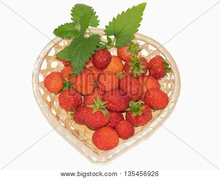 fresh strawberries in a basket isolated on a white background