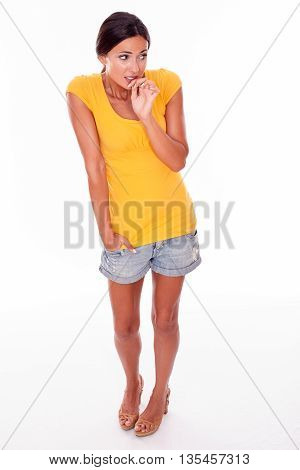 Worried Brunette With Hands To Mouth