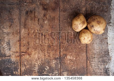 Raw Potato Food . Fresh Potatoes On Wooden Background. Free Place For Text. Top View