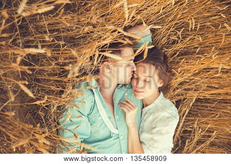 Young Couple In Love Outdoor.in Summer In Field.couple Hugging.young Beautiful Couple In Love Stayin