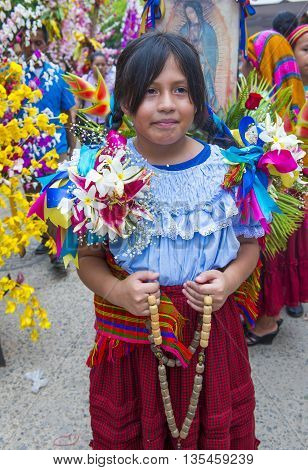 PANCHIMALCO EL SALVADOR - MAY 08 : Salvadoran girl participate in the procession of the Flower & Palm Festival in Panchimalco El Salvador on May 08 2016