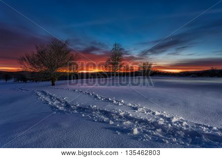 Sunrise in the snow in a cold winter day
