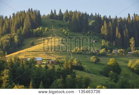 Beautiful summer landscape with village in mountains