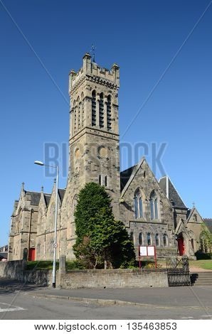 An exterior view of a church with tower in Alloa