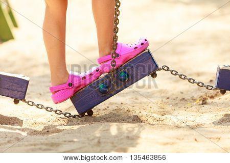 Playful Girl On Playground.