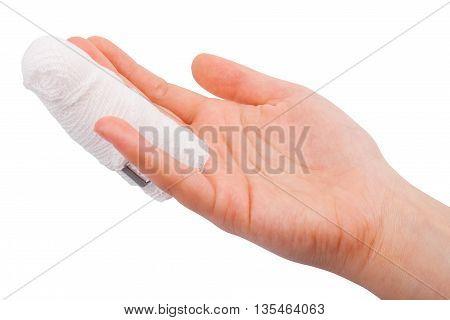 Injured finger with  bandage isolated on white background