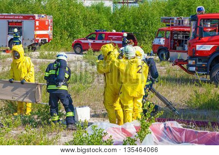 CZECH REPUBLIC, PLZEN, 4 JUNY, 2014: Fire departments and emergency teams in hazmat suits.