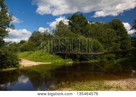Sunny day on the river, Russia, suspension bridge