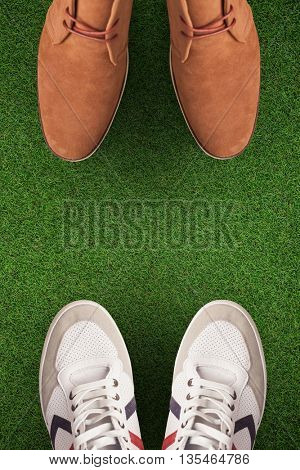 Focus of dress shoes against close up view of astro turf