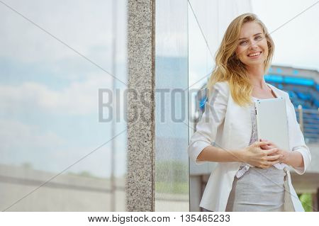 Closeup of beautiful businesswoman with electronic tablet